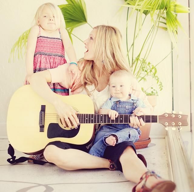 loving mother infant son little girl indoors